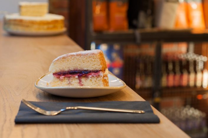 A slice of jam sponge cake