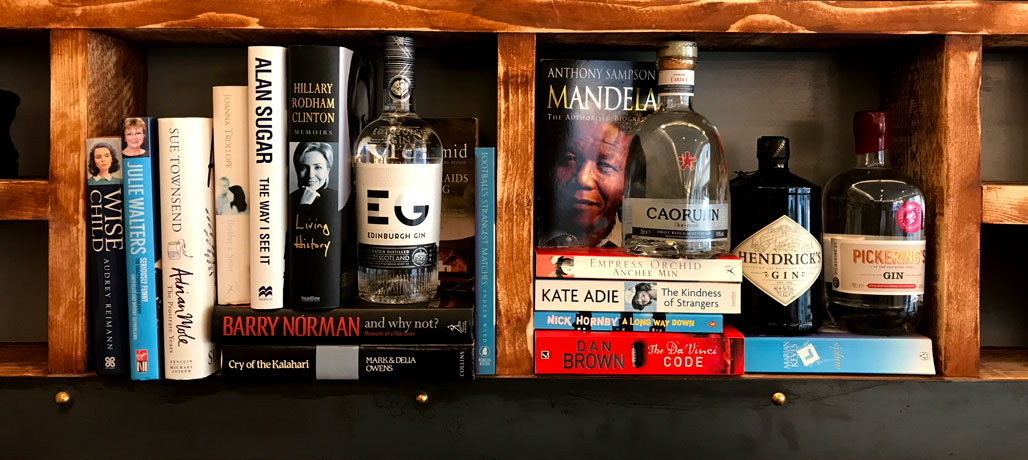 Bottles of Gin on book shelf